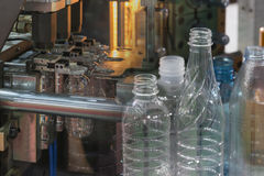 The abstract scene of plastic bottling. Process.The Blowing of plastic bottle manufacturing process Stock Photos