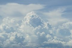 Abstract scene of powerful free form white cloud with shades of blue sky background Stock Image