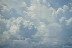 Abstract scene of powerful moving white cloud with shades of blue sky background Stock Photo