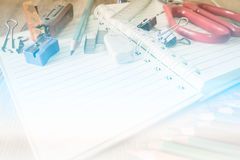 Abstract School and office supplies on wood background. Royalty Free Stock Images