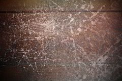 Abstract scratches on mahogany surface Royalty Free Stock Image