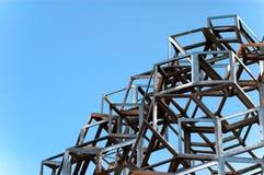Abstract sculpture. An abstract sculpture against a blue sky Stock Photos