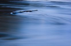 Abstract sea River. Water and wood in the move in a river Stock Images