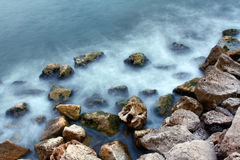 Abstract Sea and Rocks Image. Abstract Scene of the Misty Waves around some Rocks on the Coast Royalty Free Stock Photos