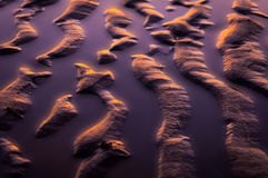 Abstract sea sand creations. At golden hour Stock Image