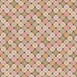 Abstract seamless background in pastel colors with geometric pattern. Abstract seamless background in cream and pink tones with a geometric pattern of squares Stock Images