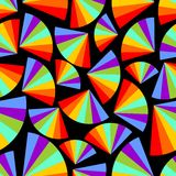 Abstract seamless background with rainbow fans in the dark area. Sharp contrasting psychedelic design Stock Images