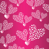 Abstract seamless background to the Valentine's day. Stock Images