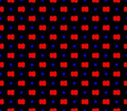 Abstract seamless black background with red flowers blue squares Stock Image
