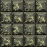 Abstract seamless black and gold pattern of cubes with beveled edges. Background of scratched black and gold mosaic tiles stock illustration