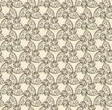 Abstract seamless brown pattern with curls. On beige background Stock Image