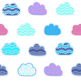 Abstract seamless gentle pattern with clouds. Colorful stylized hand drawn cloudy sky texture on light background. Cute cartoon an Stock Image