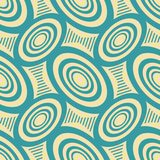 Abstract seamless geometric pattern in retro style. Abstract seamless geometric pattern of ovals and hourglass shaped striped figures in vintage colors. Retro Stock Illustration