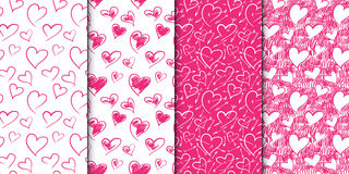 Abstract seamless heart pattern set. Hand drawn illustration. Pink and white. Set of repeating backgrounds with doodle Stock Photo