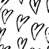 Abstract seamless hearts pattern. Ink grunge illustration. Black and white background. Royalty Free Stock Image