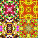 Abstract seamless kaleidoscopic background of stained glass mosaic. Set of four seamless colorful mosaic patterns in autumn colors. Red, orange, yellow, green Royalty Free Stock Photo