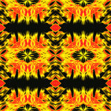 Abstract seamless kaleidoscopic infernal pattern with yellow and red fires. Gold and red hot pattern with stylized flames on a black background Stock Photo