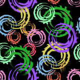 Abstract seamless pattern with big intersected painted circles. Bright colors on black background. Royalty Free Stock Photography
