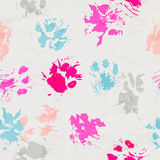 Abstract seamless pattern - black ink prints with messy cat paws. Stock Photography