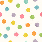 Abstract seamless pattern with bright colorful hand drawn dots. On a white background. Lovely childish backdrop for wrapping, packaging, textile and interior Stock Image