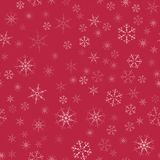 Abstract seamless pattern Christmas background of snowflakes on a red. For design of cards, invitations, greeting for the new year Stock Photos