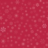Abstract seamless pattern Christmas background of snowflakes on a red. For design of cards, invitations, greeting for the new year Royalty Free Stock Photo