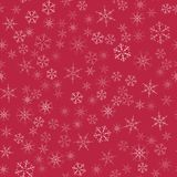 Abstract seamless pattern Christmas background of snowflakes on a red. For design of cards, invitations, greeting for the new year. Vector illustration Royalty Free Stock Photo