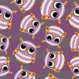 Abstract seamless pattern with colored owls. Royalty Free Stock Photography