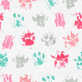 Abstract seamless pattern - black ink prints with messy cat paws. Stock Images