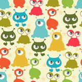 Abstract seamless pattern with cute monsters.  Stock Image
