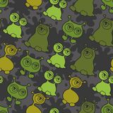 Abstract seamless pattern with cute monsters.  Stock Photography