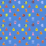 Abstract seamless pattern with cute monsters on a blue. Abstract seamless pattern with a cute monsters on a blue background Royalty Free Stock Images