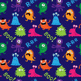 Abstract seamless pattern with decorative cute monsters Stock Images