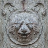 Seamless photo texture of antique stone lion head from broken castle wall. Abstract seamless pattern for designers with Middle Ages castle head of lion figure royalty free stock photography