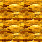 Abstract seamless pattern of folded gold and orange metal foil Stock Images