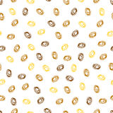 Abstract seamless pattern. Gold, yellow and brown spots. Hand-drawn dots. Funny design. The chaotic arrangement of elements.Oval Doodle Stock Images