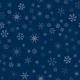 Abstract seamless pattern made of snowflakes on blue. Christmas background for design of posters, postcards, invitation for the ne. W year. Vector illustration Stock Images