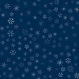 Abstract seamless pattern made of snowflakes on blue. Christmas background for design of posters, postcards, invitation for the ne. W year. Vector illustration Stock Photos