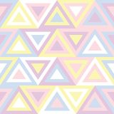 Abstract seamless pattern in pastel colors. Design based on geometric triangles colored in random style. Cute  illustration.  Royalty Free Stock Photography