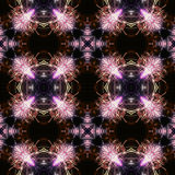 Abstract seamless pattern with pink glowing fireworks Stock Photography