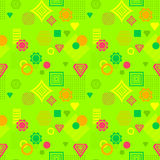 Abstract seamless pattern in postmodern Memphis Style green orange red yellow Royalty Free Stock Photos