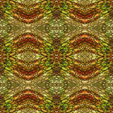 Abstract seamless pattern resembling snake skin. Green, brown, red and orange background with scales, rippling pattern and ovals resembling reptile skin Stock Image