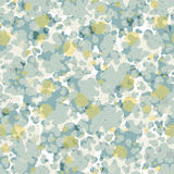 Abstract seamless pattern of rounded shapes in gray and golden colors with the texture of speckles. Stock Image