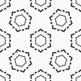 Abstract seamless pattern of six-pointed stars. Abstract seamless pattern of six-pointed stars made of triangular shapes. Fashion flat design. Symmetric vector illustration