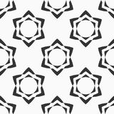 Abstract seamless pattern of six-pointed stars. Abstract seamless pattern of six-pointed stars made of triangular shapes. Fashion design. Vector background stock illustration