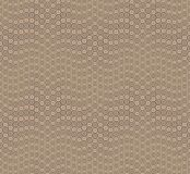Abstract seamless pattern on tan background. Has the shape of a wave. Consists of round geometric shapes. Useful as design element for texture and artistic Stock Image