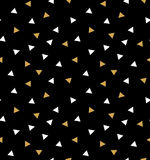 Abstract seamless pattern with triangles in gold and white on the dark gray background. Stock Photos