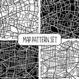Set of 4 seamless city map patterns. Abstract seamless patterns of fictional city maps, white streets on black background and black streets on white background Royalty Free Stock Photography