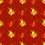 Abstract seamless red, orange and yellow pattern with fire and flames. Red, yellow and orange flames on a dark red background Royalty Free Stock Photography