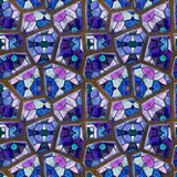Abstract seamless relief floor mosaic pattern of blue, pink and white stones on a brown background Royalty Free Stock Photo